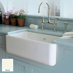 """Rohl - Rohl RC3018BS Biscuit Shaws 30"""" Handcrafted Single-Basin Fireclay - 30"""" Handcrafted, Single-Basin, Fireclay, Apron-Front Farmhouse Kitchen Sink from the Shaws Original Series With all of the activity it sees, your kitchen sink should be able to withstand it all. The fireclay kitchen sinks from Rohl's Shaws Original Sinks collection are more than able to stand up to the daily punishment, and they look amazing doing it. These durable fireclay kitchen sinks resist scratches, thermal shock, alkaline, and acids, and come in two color options. Choose from two different sinks in Rohl's Original Shaws collection: the main kitchen sink and the bar sink. Rohl RC3018 Features:  Sink Dimensions: 18"""" W x 30"""" D x 10"""" H Sink weight: 161 lbs. (not a typo - this is an extremely well-made farmhouse sink) Constructed of very thick fireclay – different than ceramic, fireclay is an extraordinarily robust mineral aggregate. Can withstand temperatures up to 2700 degrees Fahrenheit Guaranteed to never fade or stain Acid / alkali / abrasion resistant glazed surface Handmade by skilled craftsman (dimensions may vary by +/- 2%) Extra deep single basin design 8-1/2"""" Drain opening positioned left-of-center, though Rohl occasionally / randomly (10% of the time) ships this sink with drain position right-of-center Standard 3.5"""" drain opening Suitable for Insinkerator waste disposal units Due to thickness, extended disposal flange required if you plan to add a waste disposal: Rohl part number: #ISE10082 Will work with Rohl basket strainers: Rohl part number: 735 or 733 Basin rack recommended: Rohl part number: WSG3018 Made in England  About Rohl: Excellence, durability, and beauty. Family values, integrity, and innovation. These are all terms which aptly describe Rohl and its remarkable selection of kitchen a"""