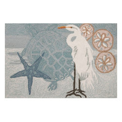 Homefires - Coastal Egret Rug - If your dreams include crashing waves, a wooden boat and life in the belly of a whale, well, you may want to buy a harpoon and hit the high seas. However, if your idea of life near the beach is more relaxing, try bringing elements of aquatic life into your home. This wool-like, washable rug features calming colors and coastal wildlife for a more peaceful ocean adventure.