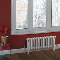 Hudson Reed - Traditional Column Radiator Heater Cast Iron Style White 11.8 x 27.8 - This cast iron style radiator, with a high quality white powder coat finish (RAL 9016), has 13 vertical triple columns that give an outstanding heat output of 519 Watts (1,770 BTUs), enough to warm a room quickly and effectively.  When combined with a set of modern valves, this up-to-date version of a classic radiator design is an ideal complement to contemporary settings, but also fits in well with traditional décor. This versatile radiator is compatible with all domestic central heating systems, will connect with your existing pipe work and is supplied complete with a wall mounting kit. For a truly authentic look, combine this traditional-style radiator with a Hudson Reed floor mounting kit (TRUSH017).  Traditional Column Radiator Cast Iron Style White 11.8 x 27.8 Details  • Dimensions: (H x W x D) 11.8 (300mm) x 27.8 (706mm) x 2.7 (68mm)• Projection When Fitted: 4.5 (115mm)• Output: 519 Watts (1,770 BTUs)• Material: Steel• Finish: White Powder Coat (RAL 9016)• Columns: 17 x 2• Wall Mounting Brackets Included• Optional Floor Mounting Kit Available - See Essential Extras Above• Please note: Angled Radiator Valves are required, please choose from the options above. 5 Year Guarantee on materials and finish Please Note: Our radiators are designed for forced circulation closed loop systems only. They are not compatible with open loop, gravity hot water or steam systems.