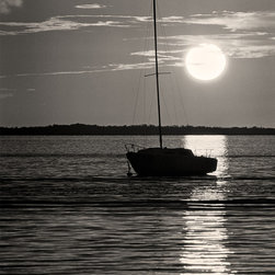The Andy Moine Company LLC - Sail Boat at Sunset Key Largo Florida Keys Fine Art Black and White Photography, - Black and White Fine Art Photography captured with 35MM Ilford Film and reproduced in Limited Editions on Brushed Aluminum. This is a beautiful composition of a Sail Boat in Silhouette with the sun setting in the background at picturesque Key Largo in the Florida Keys.