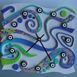 Aurora Borealis Polymer Clay Art Clock by Mystic Dreamer Art - This fascinating piece is a clock. The artist has lots of amazing offerings, and by buying this one, you save 150 acres of rainforest. An astonishing 100 percent of the profits are donated to the Rainforest Trust.