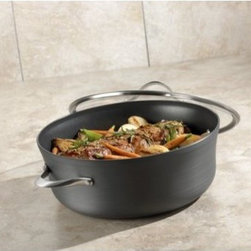 Calphalon Contemporary Nonstick 8.5 qt. Dutch Oven with Lid - Pasta, veggies, rice, beans, and more - drain and strain 'em all with the Calphalon Contemporary Nonstick 3.5 qt. Pour and strain Sauce Pan. It's easy thanks to the pourable pan shape and integrated straining holes in the lid - you'll never have to use a separate colander again. And this pan is built tough - the heavy-gauge, hard-anodized aluminum distributes heat evenly, and the nonstick surface is triple-layer and PFOA-free. Best of all, this pan is dishwasher safe for easy, breezy cleanup and oven safe up to 450 degrees Fahrenheit. Includes manufacturer's full lifetime warranty.About CalphalonCalphalon's mission is to be the culinary authority in kitchenwares, enhancing the home chef's food experience during planning, prep, cooking, baking, and serving. Based in Toledo, Ohio, Calphalon is a leading manufacturer of professional quality cookware, cutlery, bakeware, and kitchen accessories for the home chef. Calphalon is a Newell-Rubbermaid company.Calphalon's goal is to give you, the home chef, all the tools you need to realize your highest potential in the kitchen. From your holiday roasting pan to your everyday fry pan, count on Calphalon to be your culinary partner - day in and day out, for breakfast, lunch, and dinner for a lifetime.