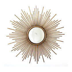 Sunburst Antiqued Gold Wall Mirror by Two's Company® - Starburst Mirrors resurfaced on the design scene during the Hollywood Regency explosion, and it seems they are here to stay. We love the smaller mirror and delicate starburst arms on this particular gold model.