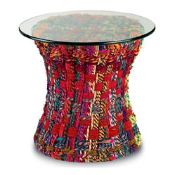 "ecofirstart.com - Mandara Table - This funky, global-style table is sure to rope you in. Colorful cotton fabric is braided into ropes called ""chindi,"" and woven around the sturdy wire frame of this glass-topped accent table. Since the cloth is recycled, no two are exactly alike."