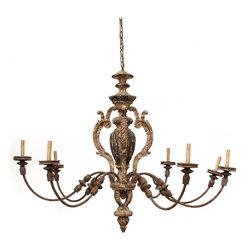 Elysee Chandelier - When an elegant chandelier crowns your formal room, it imparts its baroque lavishness to all the furnishings and ornaments below. Render your space glorious with the eight embellished arms of the Elysee Chandelier, whose old-world bronze patina over warm, worn ivory serves to highlight the fine three-dimensional details of its arching, curving lines. This ceiling-mounted candelabra with its rustically antiqued rococo features is hard-wired for use in your traditional room.