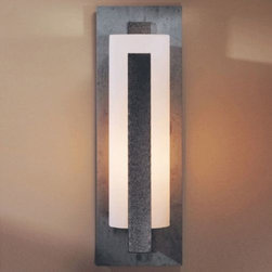 Hubbardton Forge - Forged Vertical Bars Outdoor Wall Sconce-Wet by Hubbardton Forge - The Hubbardton Forge Forged Vertical Bars Outdoor Wall Sconce-Wet enhances your exterior decor with a handcrafted beauty. The Forged Vertical Bars Outdoor Wall Sconce-Wet features hand-blown glass shade and aluminum body.Hubbardton Forge, headquartered in Hubbardton, Vermont, hand-forges simple and elegant metal lighting fixtures and accessories, combining ancient hand-forging techniques with environmentally-sound finishing practices.The Hubbardton Forge Forged Vertical Bars Outdoor Wall Sconce-Wet is available with the following:Included Features:Hand-blown, closed-top tube-shaped glass shade.Front accent vertical bar.Aluminum body.Wall plate.UL Listed for wet locations.Options:Backplate: Aluminum, or Slate.Front Accent Vertical Bar Finish: Black, Natural Iron, Opaque Bronze (shown), Opaque Burnished Steel, Opaque Dark Smoke, or Opaque Mahogany.Glass Color: Opal (Acid-etched with White interior casing) (shown), or Stone (Acid-etched with Soft Earth Tone exterior and White interior casing).Lamping: Fluorescent, or Incandescent.Size: Large, Medium, or Small (shown).Lighting:Large Fluorescent option utilizes one 13 Watt 120 Volt Type GU24 Fluorescent lamp (included).Large Incandescent option utilizes one 150 Watt 120 Volt Type A Medium Base Incandescent lamp (not included).Medium Fluorescent option utilizes one 13 Watt 120 Volt Type GU24 Fluorescent lamp (included).Medium Incandescent option utilizes one 100 Watt 120 Volt Type A Medium Base Incandescent lamp (not included).Small Fluorescent option utilizes one 13 Watt 120 Volt Type GU24 Fluorescent lamp (included).Small Incandescent option utilizes one 100 Watt 120 Volt Type BT-15 Medium Base Incandescent lamp (not included).Please Note: This item is hand-forged by master craftsmen and includes hand-blown glass. As a result, variations in finish appearance and small blemishes, bubbles, and variations in the color of the glass are a n
