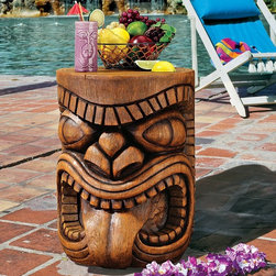 Design Toscano - Design Toscano The Grand Tiki Tongue Sculptural Table - DB383075 - Shop for Tables from Hayneedle.com! Give yourself a little Tiki-time with the Grand Tiki Tongue Sculptural Table. This happy Tiki head is made of a faux wood grain resin and is sturdy fun and full of Tiki charm.About Design Toscano: Design Toscano is the country's premier source for statues and other historical and antique replicas which are available through our catalog and website.We were named in Inc. magazine's list of the 500 fastest growing privately-held companies for three consecutive years - an honor unprecedented among catalogers.Our founders Michael and Marilyn Stopka created Design Toscano in 1990. While on a trip to Paris the Stopkas first saw the marvelous carvings of gargoyles and water spouts at the Notre Dame Cathedral. Inspired by the beauty and mystery of these pieces they decided to introduce the world of medieval gargoyles to America in 1993. On a later trip to Albi France the Stopkas had the pleasure of being exposed to the world of Jacquard tapestries that they added quickly to the growing catalog. Since then our product line has grown to include Egyptian Medieval and other period pieces that are now among the current favorites of Design Toscano customers along with an extensive collection of garden fountains statuary authentic canvas replicas of oil painting masterpieces and other antique art reproductions.At Design Toscano we pride ourselves on attention to detail by traveling directly to the source for all historical replicas. Over 90% of our catalog offerings are exclusive to the Design Toscano brand allowing us to present unusual decorative items unavailable elsewhere. Our attention to detail extends throughout the company especially in the areas of customer service and shipping.