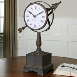 Uttermost Rustic Armillary Clock - 16H in. - The Uttermost Rustic Armillary Clock brings a stately vintage presence to your desk or table top. The hand forged metal body with its dark rust bronze finish harkens back a time of explorers hovering over their unfinished maps and astronomers navigating the cosmos in their observatories. The metal spherical bands and prominent arrow exude industrious craftsmanship. Complementing its rustic beauty is the engineered practicality. The Uttermost Rustic Armillary Clock uses quartz movement, the world's most widely used timekeeping method, to keep track of time accurately and reliably. The weathered Roman numerals give a nod to the Old World.About UttermostThe mission of the Uttermost Company is simple: to make great home accessories at reasonable prices. This has been their objective since founding their family-owned business over 30 years ago. Uttermost manufactures mirrors, art, metal wall art, lamps, accessories, clocks, and lighting fixtures in its Rocky Mount, Virginia, factories. They provide quality furnishings throughout the world from their state-of-the-art distribution center located on the West Coast of the United States.