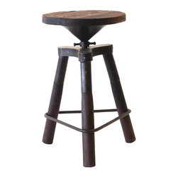 Bale Counter Height Swivel Stool - The Bale Swivel Stool is an attractive, practical option for any dining space. Counter height and constructed of rugged iron and a sustainably harvested mango wood seat, the Bale Swivel Stool will welcome your guests with rustic old world charm. It's Victorian factory inspired style is adds character to your dining experience. Handmade sustainable solid mango wood round swivels 360� on steel and wood three point base with burned wax finish for raw, welded look.