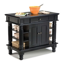 "Home Styles - Kitchen Island - Features: -Antiqued pewter hardware.-Accessible from both sides.-Easy glide large pass through drawer.-Raised detail cabinet doors on each side for easy access.-Open storage with shelves on each end framed by distinctively detailed columns.-Top section with drawer.-Solid hardwoods and engineered wood construction.-Rich multi step ebony finish.-Product Type: Kitchen Island.-Collection: Americana.-Base Finish: Black.-Counter Finish: Black.-Hardware Finish: Antiqued pewter.-Distressed: Yes.-Powder Coated Finish: No.-Gloss Finish: No.-Base Material: Wood.-Counter Material: Wood.-Hardware Material: Antique pewter.-Solid Wood Construction: Yes.-Number of Items Included: 1.-Water Resistant or Waterproof Cushions: No.-Stain Resistant: No.-Warp Resistant: No.-Exterior Shelves: Yes -Number of Exterior Shelves: 6.-Adjustable Exterior Shelving: No..-Drawers Included: Yes -Number of Drawers: 1.-Push Through Drawer: Yes..-Cabinets Included: Yes -Number of Cabinets : 1.-Double Sided Cabinet: Yes.-Adjustable Interior Shelves: Yes.-Number of Doors: 4.-Locking Doors: No.-Door Handle Design: Knobs..-Towel Rack: No.-Pot Rack: No.-Spice Rack: No.-Cutting Board: No.-Drop Leaf: No.-Drain Groove: No.-Trash Bin Compartment: No.-Stools Included: No.-Casters: No.-Wine Rack: No.-Stemware Rack: No.-Cart Handles: No.-Finished Back: Yes.-Commercial Use: No.-Recycled Content: No.-Eco-Friendly: No.-Product Care: Clean with a damp cloth.Specifications: -ISTA 3A Certified: Yes.Dimensions: -Overall Height - Top to Bottom: 36"".-Overall Width - Side to Side: 42"".-Overall Depth - Front to Back: 24"".-Width Without Side Attachments: 42"".-Countertop Thickness: 0.75"".-Countertop Width - Side to Side: 42"".-Countertop Depth - Front to Back: 24"".-Shelving: Yes.-Leaf: No.-Drawer: -Drawer Interior Height - Top to Bottom: 3.5"".-Drawer Interior Width - Side to Side: 19.125"".-Drawer Interior Depth - Front to Back: 19.25""..-Cabinet: -Cabinet Interior Height - Top to Bottom: 19.75"".-Cabinet Interior Width - Side to Side: 18.5.-Cabinet Interior Depth - Front to Back: 20.5""..-Overall Product Weight: 165 lbs.Assembly: -Assembly Required: Yes.-Tools Needed: Phillips screwdriver.-Additional Parts Required: No.Warranty: -Product Warranty: Vendor replaces parts for 30 days."