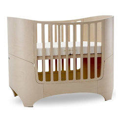 "Leander - Two Piece Crib Set in White Wash - The Leander collection combines a simple, functional and aesthetic design, while transitioning in functionality parallel with the growth of your child. The oval crib mirrors a child's growth stages from infant to early tween (8-9 yrs. old.) The unit has four stages: crib (with 2 mattress heights), daybed, transition bed and junior bed. All needed conversion components are included with the crib packaging. The collection is made of moulded European beech and is surface treated with a water based lacquer. The mattresses have interior pocket springs for improved comfort and ventilation. The mattress covers are made of Eco-Tex 100 cotton and are machine washable. Leander combines natural and eco-friendly components to provide a safe environment for your child's primary comfort zones. Features: -Finish: White Wash. -Constructed from beech bent plywood. -Converts into day bed and junior bed 27"" x 60"" long. -Changing table convert into a computer desk. -Conversion rails for junior bed included. -Adjustable mattress 2 positions. -Ergonomic design for small rooms. -Shaped gate for easy access to the baby. -Included: Changing pad, 2 storage boxes, and 1 drawer on glides. -Crib dimensions: 38"" H x 48"" W x 28"" D. -Changing table dimensions: 39.5"" H x 28.5"" W x 28.5"" D. This is a NON-Drop Side crib"
