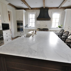 Atlanta Homes & Lifestyles Christmas House- natural stone provided by Levantina - Calacatta Gold (Honed Finish) marble countertop, marble kitchen, white marble, Calacatta Gold, kitchen island