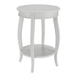 Powell Furniture - Round Side Table in White Finish - Contemporary style. Round lower shelf. Ample storage space. Bentwood skirt and saber cabriolet tapered legs. Made from MDF and solid wood. Minimal assembly required. 18 in. Dia. x 24 in. H (14 lbs.)Perfect accent piece for any room in your home.