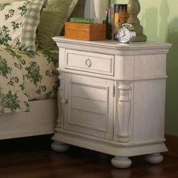 Placid Cove 1-Door 1 Drawer Nightstand - Honeysuckle White - Brimming with country-inspired charm, the Placid Cove 1-Door 1 Drawer Nightstand - Honeysuckle White instantly evokes a cozy bed and breakfast. You're going to love how the poplar solids and poplar veneers are finished in a Honeysuckle White hue, which highlights turned side columns and bun feet. A lower cabinet with a louvered front is always handy, but what you'll really love is the drawer. In addition to sturdy dovetail joinery and smooth ball bearing glides, it's got a decorative print bottom with an electric outlet bar and wiring access hole. Charging your phone overnight has never been easier. Base levelers complete the design.Notes on Riverside ConstructionAll Riverside domestic furniture is constructed of fine oak, ash, poplar, and pine wood. These wood types are durable and feature beautiful, open grains that make them much preferred among furniture manufacturers. Each piece of wood is first graded for quality, then kiln-dried to remove excess moisture and prevent splitting. The wood is then constructed into a high-quality furniture piece using a combination of hardwood solids and hand-selected veneers. Techniques used on Riverside pieces include dovetail joinery, heavy-duty drawer roller guides, and multi-step finish applications that include hand-sanding and polishing for a deep, lustrous result. All Riverside furniture is given this high-quality treatment to ensure the beauty and durability of your final product.About Riverside FurnitureRiverside has been growing for more than half a century. The company's founder, Herman Udouj, opened the doors to his first factory in 1946, and along with 12 employees, he began making handcrafted furniture for the post-World War II Baby Boom era. Since then, generations of customers have furnished their homes and offices with Riverside's wide range of furniture products. Riverside strives to be trusted for quality products that are an affordable value. It's just that simple.Care and MaintenanceIt's recommended that Riverside furniture be cleaned with a damp, clean dust cloth. Any kind of surface or finish may be cleaned using this method. A mild detergent may be applied, if necessary, for areas that will not clean with just a cloth. Avoid the use of oil-based polishes and direct-spray polishes that can cause a waxy build-up.Placing hot items, such as coffee mugs or dinner plates on a piece of furniture can soften the finish. Condensation from cold objects or liquid spills will cause the finish to bubble and leave a milky-white discoloration. Never use fingernail polish remover over a wood finish because if it makes contact with the finish it will eat through it much like a paint or varnish remover exposing the wood underneath and demanding that the surface be refinished to repair the damage. The damage described above can be eliminated by the use of coasters, trivets, and common sense.Always use a protective pad beneath lamps or accessories, and on writing surfaces. Do not place rubber or vinyl products on the surface as discoloration and/or staining may occur as a result.