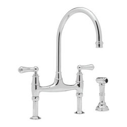 Perrin & Rowe Bridget Faucet with Sidespray - A bridge faucet is such a traditional and classic style, and this one from Perrin & Rowe is a perfect case in point. I'd pair it with a farmhouse-style sink to complete the look.