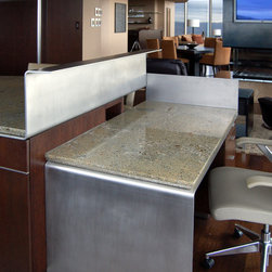 """Lincoln Penthouse - Desk at Kitchen Island: made from 3/8"""" stainless steel plate with stone top with back-beveled edge. Stainless steel plate has mill finish, slightly sanded, with wax finish. Stone by others. Photo credit: Carrie Simmons, Decorative Metal Arts"""