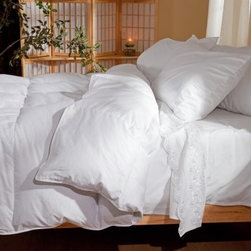 Belle Epoque Glory Down Comforter - Winter Weight - Geese are comfortable migrating in cold weather and you can benefit from their seemingly magical adaptations with the Belle Epoque Glory Down Comforter - Winter Weight. Stuffed with copious amounts of fluffy warm down this heavy blanket will keep you toasty warm even on freezing nights.With a cover made from high thread count 100% cotton this comforter is stuffed with European white goose down with a luxurious fill power of over 650. The baffled box-stitch construction uses an inner wall of fabric to let the fill loft to achieve its maximum capacity while the quilted pattern keeps the stuffing evenly distributed throughout the comforter. This comforter is conveniently machine-washable and is backed by a three-year limited warranty.Comforter Dimensions:Twin: 66 x 88 inchesFull/Queen: 92 x 95 inchesKing: 110 x 95 inchesAbout CGG Home FashionsWhether you are shopping at Bloomingdale's or relaxing at a premier resort you are sure to find and appreciate CGG Home Fashions products. For over 20 years the company has been offering a broad selection of luxury linens high thread count sheets duvet covers pillows down and synthetic comforters drapes and table linens. CGG's acclaimed Belle Epoque collection is the epitome of elegance with styles ranging from traditional to contemporary. With offices and a warehouse in Yonkers New York and a showroom on New York's Fifth Avenue CGG is at the epicenter of textile design and innovation.