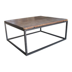 "R.T. Facts - Reclaimed Wood Top Coffee Table - Rustic, yet urban, this durable coffee table features a wooden surface culled from an antique French farm table. The beautiful top paired with an iron base will have you saying, ""Oui!"""