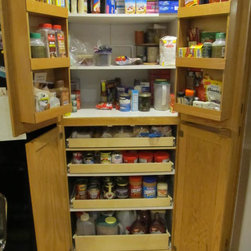 Pull Out Pantry Shelves - Create an organized pantry with custom pull out shelves from ShelfGenie of Portland, designed to fit your existing space.  Increase your ability to see and reach stored in your pantry, ultimately saving you time and money.