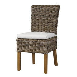 Home Decorators Collection - Asher Parsons Chair - For a wicker dining chair with simple elegance, look no further than our Asher Parsons Chair. The natural fiber rattan of this woven chair boasts a soft grey tone. The kubu wicker is soaked in local clay and sun-dried to achieve this beautiful, natural color. Woven of natural kubu wicker. Clear topcoat preserves the natural color and protects against spills. Wood legs in natural finish. Includes white cotton cushion.