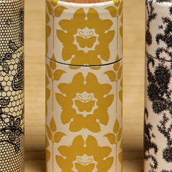 Cylinder Match - Butterfly Batique - Present necessities elegantly with the Butterfly Batique Cylinder Matches, a handsome, simply-designed matchbox that echoes the general form of a stylish pillar candle and is finished with a golden damask pattern featuring stately silhouettes of butterflies.  This polished detail looks graceful on a bathroom counter next to scented candles or on a bookshelf in your living space.