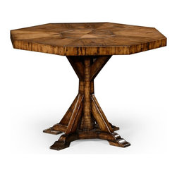 Jonathan Charles - Jonathan Charles Huntingdon Light Walnut Sawn Distressed 42 Octagon Dining Table - Solid walnut Country living style octagonal centre or dining table with bracketed central column base and exposed saw marks to the rustic finish. Jonathan Charles Fine Furniture is the vision of Jonathan Sowter an English furniture designer who excels at the art of fine antique reproduction. Jonathan Charles designs and manufactures the highest-quality European antique replicas as well as their own unique transitional designs. What makes them different is their meticulous attention-to-detail and pursuit of high-quality construction. Their passion for detail is also reflected in their in-house brass foundry in which they manufacture their own hardware so that when they design a new piece of furniture they can also design one-of-a-kind pulls hinges locks and even keys for that piece. Jonathan Charles works with artisans who display a large range of skills. They take pride in their work which is evident in their beautifully-crafted antique replicas. They go far beyond just creating furniture that resembles English classics. They employ age-old techniques which breathe soul and lasting-quality into their products.  Many of their inspirations come from original antiques that Jonathan discovers in his travels. Sometimes they will reproduce them as accurately as possible while at other times they will take a detail that they like and design a completely new piece of furniture around that feature.  Oftentimes they will start the design process from scratch. They gather inspiration from a variety of sources – be it a classic wallpaper design nature classic antiques a rare object or jewelry.  They never design to the limitations of their factory and have actually expanded their factory as they have developed new skills in advanced marquetry bronze casting hand carving and much more.  They never compromise on design and would be foolish to compromise on quality. Only the fines