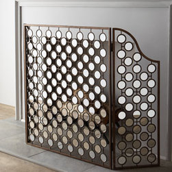Horchow - Mirrored Fireplace Screen - A little bit retro, quite a bit artsy, and completely fabulous, this fireplace screen sees to it that the fireplace remains the focal point of the room even when the fire isn't lit. Hand-forged metal with an antiqued golden finish. Insets of mirrored....