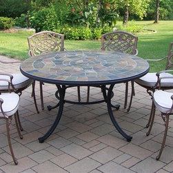Oakland Living - Stone Art 7-Pc Outdoor Dining Set - Includes table, six arm chairs with cushions. Fade, chip and crack resistant. Solid and sturdy yet trendy designs. Brass hardware. Warranty: One year limited. Made from natural stone and rust free cast aluminum. Hardened powder coat finish in antique bronze. Minimal assembly required. Table: 54 in. Dia. x 29 in. H. Dining chair: 23 in. W x 22 in. D x 35.5 in. H (23 lbs.)Our stone art dining sets will be a beautiful addition to your patio, balcony or outdoor entertainment area. Stone art dining sets are perfect for any small space or to accent a larger space. The Oakland Stone Art Collection combines natural stone and modern designs giving you a rich addition to any outdoor setting.