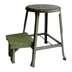 Pre-owned Industrial Sage Green Step Stool - A metal Industrial sage green step stool with wooden steps that fold back into the stool for a more compact profile. It has the perfect rustic patina with splatters of paint and patination throughout. It still works as a serviceable step stool, but makes for a charming, rustic accent as well.