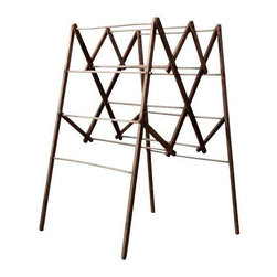 "Antique Wood Drying Rack - This antique drying rack is collapsible! It has pegged wood bars and is in good condition for it's age. There is a metal screw and wire repair on one of the top bar hinges. And there are two spots were the wood has splintered/cracked.  Measures: 44.5"" H x 26"" W x 26"" D extended, 44.5"" H x 26"" W x 5"" folded"