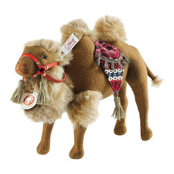 """Steiff - Steiff Karim Camel - Camels were among the earliest Steiff animals - in fact, the first trademark for Steiff felt animals even features a camel ... Which means that Karim camel is part of a rich tradition at Steiff. The first in his line appeared in 1898 - a less elaborate version on wheels. His great-grandson Karim, who is 25 cm tall and made of finest brown wool felt, prefers to stand on his own four hooves. He also loves his lavishly decorated saddlecloth - patterned with gold trimming and gold-coloured tassels. His head is adorned with a red leather halter and a gold-coloured tassel on either side. His gold-plated """"Button in Ear"""" and the rich, gently curling fur single him out as a descendent of a very special family. Handmade by Steiff in Germany and limited to only 1,500 pieces."""
