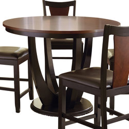 "Steve Silver Furniture - Steve Silver Oakton Round Counter Table in Black and Chestnut - The rich, modern-retro style of the Oakton Dining Collection, with its sculptural details and easy functionality, makes it a stand out. The Oakton counter table features a 48"" round top supported by a unique pedestal base. This stunning counter table when paired with Oakton counter chairs, will seat four comfortably."
