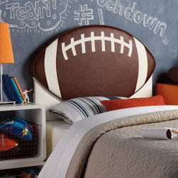 Powell Upholstered Football Twin Headboard - Perfect for your little athlete, the Powell Upholstered Football Twin Headboard will be the centerpiece of our your little guy's bedroom. This headboard has a wood frame shaped like a huge football upholstered in brown and white polyurethane. It easily attaches to twin size bed rails and easily wipes clean with a damp cloth. Sure to create a fun place for your child to sleep. More About Powell FurnitureBased in Culver City, Calif., the Powell company designs, imports, and distributes occasional, dining, accent, and youth furniture across all style categories. Since 1968, Powell has grown to become one of the most recognized names in the home furniture industry. From sturdy, safe children's furniture to elegant bedroom and other home collections, Powell continues to develop new and exciting designs for homes around the globe.