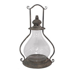 Heather Fields Home & Garden - Lantern with Glass Hurricane - Lantern with glass hurricane to protect your candle from blowing out. Metal body. Can also hang.
