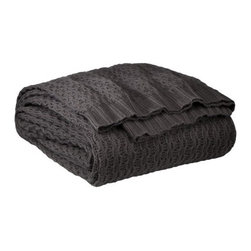 Target Home Cotton Blanket - Without making a huge dent in your design budget, this knit throw will put your cold toes to rest. Available in a variety of colors, you can make it work almost anywhere.