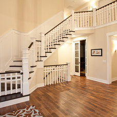 Traditional Staircase by Robert Lucke Homes
