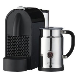 Nespresso® U Espresso Maker Bundle - Fully automatic espresso maker with 19 bars of pressure ensures maximum flavor extraction from Nespresso's premium coffee capsules (an assortment of 16 is included) with locked-in freshness and mess-free convenience. You select your cup size and pour size for a single, double or triple shot, and can even choose the brewing duration based on your preference. Spent capsules are neatly ejected into an internal receptacle (holds up to 12). Movable 27-ounce water tank is easy to fill; magnetic drip tray is removable to accommodate a larger cup. The U is joined by the Aeroccino Plus chrome frother: two whisk attachments prepare two servings of milk to transform your espresso into a cappuccino, macchiato or latte (or heat milk for cocoa and recipes). Dual steam and froth features perform to perfection at the touch of a button; nonstick interior makes for easy cleanup. Calibrated pitcher lifts off base for convenience.