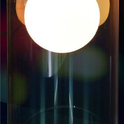 Zuo Modern - Cylindrical Glass Table Lamp - Includes one bulb. Requires one 40 watt Type A bulb. UL listed. Socket: E12. Warranty: One year limited. Made from glass. Clear color. No assembly required. 10 in. L x 7.9 in. W x 15.8 in. H (5.95 lbs.)The frosted orb within the clear glass cylinder will give the illusion of a floating warm ball illuminating its surroundings.