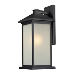 One Light Black White Seedy Glass Wall Lantern - Clean, straight lines and rectangular detailing define the classic styling of this large outdoor wall mount. White seedy glass panels create an elegant glow, while the cast aluminum hardware finished in black can withstand nature's seasonal elements.