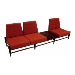1960s by Liceu de Artes - Something about this sofa looks like it came from the waiting room of some super-chic analyst's office in the 1960s. Or Garbrielle Byrne's on In Treatment. It will up the grooviness quotient in whatever room you place it in.
