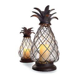 """Pineapple Hurricane Lantern - I'm turning my home into a tropical oasis and these pineapple hurricanes are a must for my front entry! Even though they are kind of """"theme-y,"""" I still love their shape and color."""
