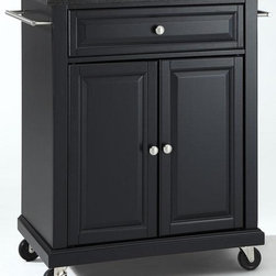 Home Decorators Collection - Grantham Kitchen Cart - Constructed of solid hardwood and wood veneers, this mobile kitchen cart is designed for longevity. The beautiful raised panel doors and drawer fronts provide the ultimate in style to dress up your kitchen. Two deep drawers are great for anything from utensils to storage containers. Behind the four doors, you will find adjustable shelves and an abundance of storage space for things that you prefer to be out of sight. Heavy duty casters provide the ultimate in mobility. Casters lock to prevent movement.
