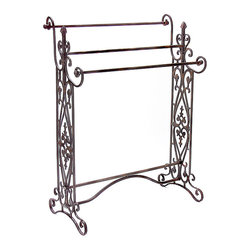 None - Iron Corazon Quilt/ Towel Rack - This Corazon quilt and towel rack features ornate filigree designs. Crafted of wrought and cast iron, this accent piece will make an alluring addition to any home decor.