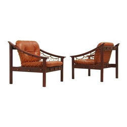 Jean Gillon - Pre-owned Amazonas Brazilian Jacaranda Sling Lounge Chairs - An EXOTIC pair of Amazonas Brazilian Jacaranda sling lounge chairs by Jean Gillon. These stunning Mid-Century Modern chairs feature Jacaranda, leather and beautiful exposed net back and side support. Made in Brazil, circa 1950s.