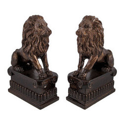 Pair of Decorative Lion Bookends Bronze Finish - This set of lion bookends is a wonderful addition to any bookshelf, mantel, desk, or table in your home or office. Made of cold cast resin, each measures 8 inches tall, 5 inches long, and 2 1/2 inches wide. The bookends have glossy bronze finish that make them look like metal. This set is a lovely gift for the avid reader in your life, and is sure to be admired.