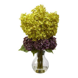 Nearly Natural - Bostonian Hydrangea Arrangement - Includes faux water and glass vase. Green and purple color. Vase: 4.5 in. Dia. x 7 in. H. Overall: 14 in. Dia. x 25 in. HEnjoy the beauty of these full bloom hydrangeas for years to come. The Hydrangea is one of nature's more interesting flowers. The blooms are small on an individual level, yet together, they combine to create an almost pillow-like texture of color. We've captured that perfectly in this mixed Hydrangea arrangement, with two different blooms resting on lush, green leaves. And best of all, it'll never need care or water. Makes a perfect gift.