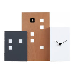 Progetti - Walls Cucu 2275 Brown/White Wall Clock - Walls Cuckoo is a wall or table cuckoo clock, made of painted wood, which, thanks to three volumes of different heights and depths, creates the skyline of a modern city built of buildings and skyscrapers. Unlike the profiles of average towns, Walls Cuckoo is a linear and material object which recreates, in its compactness, the third dimension. Battery quartz movement.