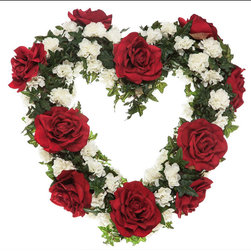 22in. Heart Shaped Rose Wreath, Red/White - Next February, celebrate all the love in your life with our 22in. Heart Shaped Rose Wreath in Red/White. The wreath has a leafy green base that is decorated with beautiful large red roses and smaller white carnations. Since this wreath is made with faux flowers, it is suitable for outdoor use. It would also look gorgeous hanging in your living room or above your mantel. If you've been on the hunt for gift ideas, then our Valentine's Day wreaths may be just what you've been looking for; these wreaths are perfect gifts for your mother, sisters, aunts, or your child's classroom.