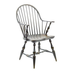 Pre-owned Bench-Made Windsor Chair - A classic Windsor chair with a continuous arm form, hand built by a PA craftsman, probably about 30 - 40 years ago. Remarkably comfortable. The seat is contoured and thick, as is typical of American Windsor chairs. The splayed legs and arm supports have a nice chunky turned shape. The finish is dark brown, blackish in some places, a bit lighter with wear in some places. We can have the chair painted a solid color if you like (for an additional price) though we like it this way. The wear and variation in the finish allow you to see evidence of the hand construction.    This chair offers a crisp graphic silhouette, especially with the curve and linear spindles of the back. It is an iconic traditional shape that can easily blend into a more modern setting. Shallow enough to tuck back against a wall until you need it, or to sit near a desk. Sturdy enough for anyone in the family to use.