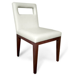 Canal Upholstered Dining Chair - The Canal is an elegant contemporary upholstered dining chair with a sturdy wooden base and legs. The Canal chair can serve multiple purposes, such as a task, side or dining chair. This side chair's optional cut out in the back rest allows the user to easily pick up and move the chair.